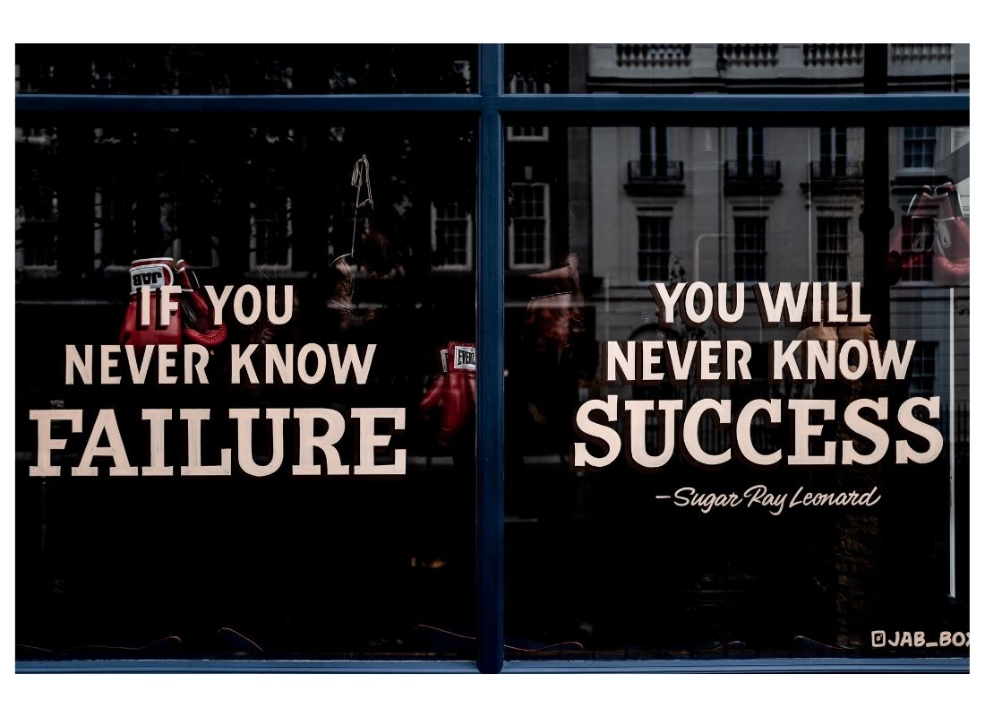 failure quote printed on shop window