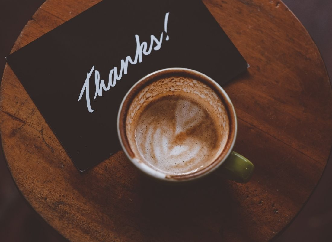 Thank you card next to latte