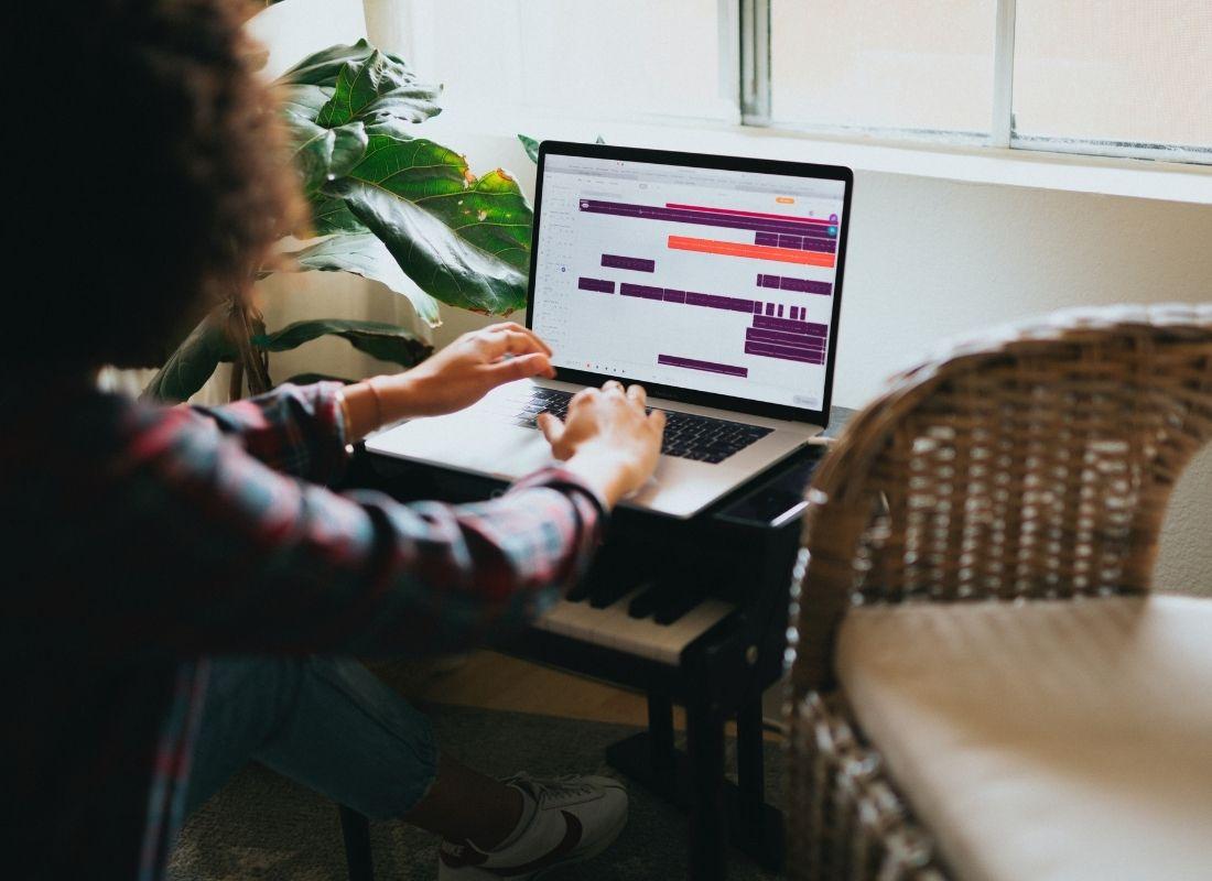 Woman checking work calendar on laptop