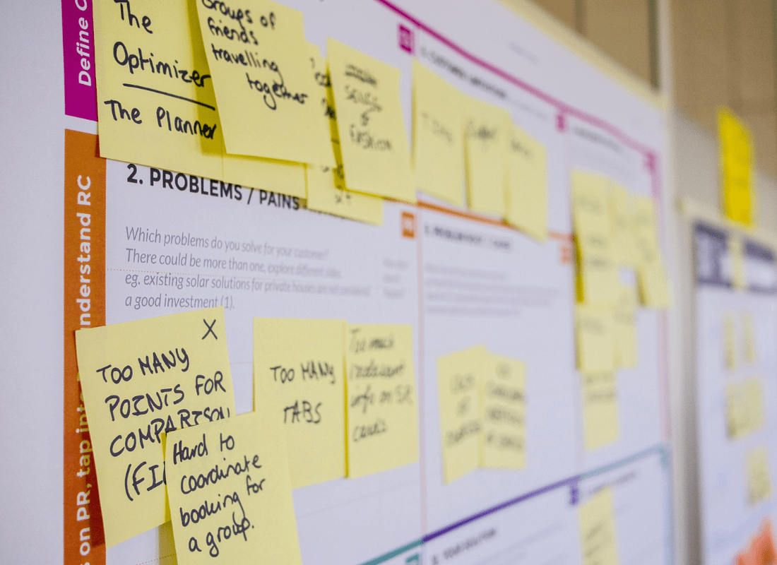 Team input on sticky notes on planner board
