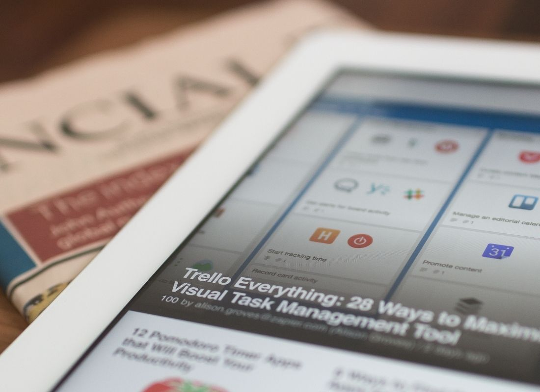 Tablet with article on marketing tips next to newspaper